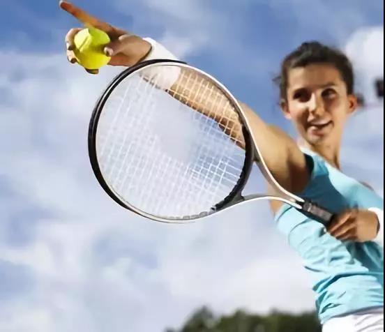 playing tennis ball machine